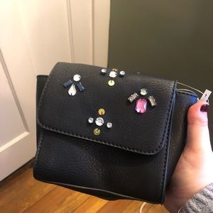 Brand new- never used- tags still on.Candies Purse